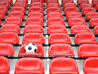 football on stadium chairs