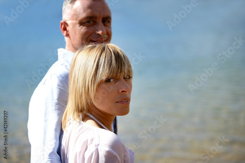 Couple taking romantic stroll along beach