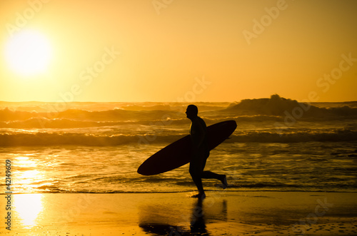 Surfer running