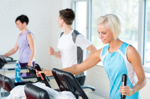 Fitness young people on treadmill running exercise
