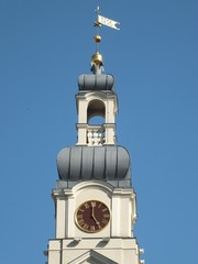 Decorative turret with clock and weathervane (Riga, Latvia)