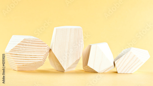 Wooden blocks on yellow background
