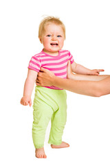 Infant learining how to stand