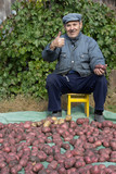 An elderly man with a crop of potatoes