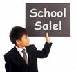 School Sale Sign Shows Student Discounts