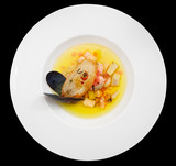 Fish soup isolated on black background