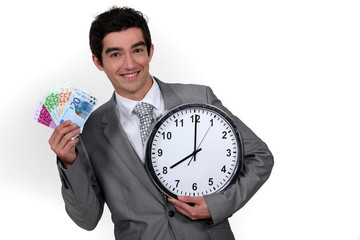 Young businessman with a wad of cash by 8 o'clock