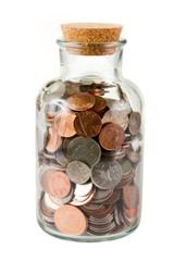 Glass bottle full of coins