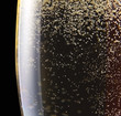 champagne in wineglass on a black background