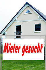 Advertising sign in front of house
