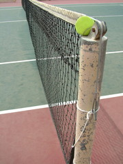Tennis ball on the Tennis Net