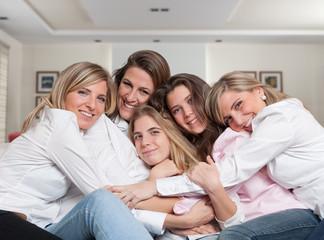 Female family sofa cuddle close