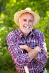 Senior gardener with straw hat