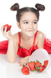 Little girl with strawberry on white background