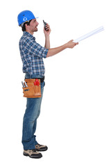 Tradesman trying to communicate with his colleague