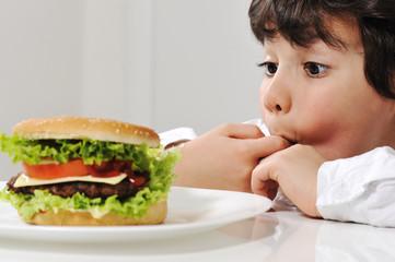 Little boy and burger