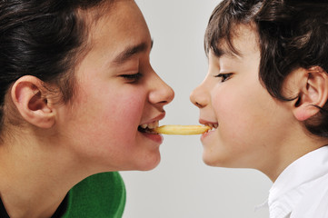 Sister and brother eating french fries