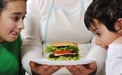 Mom prepared delicious hamburger for little kids