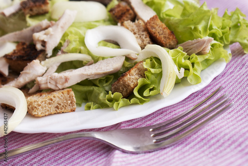 Creative salad from fresh vegetables with meat of a hen