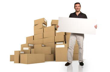 Man with sign and piles of boxes