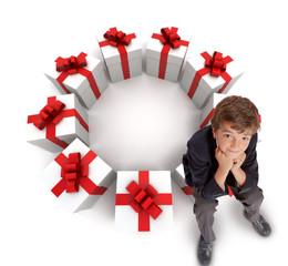 Boy sitting on presents