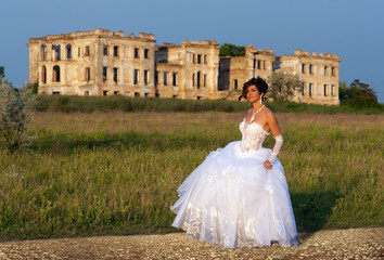 Full length portrait of bride with the ruins on the background