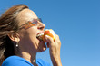 Healthy life: woman eating apple