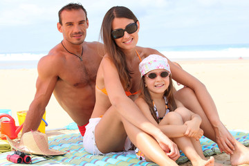 Parents with daughter at the beach