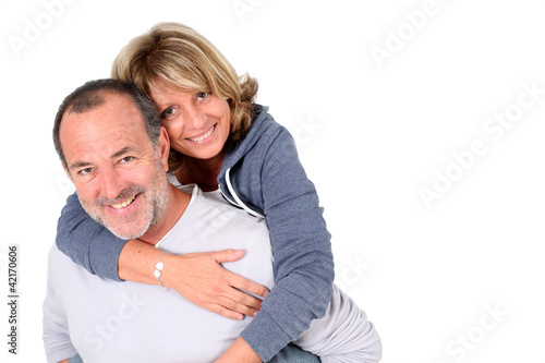Senior man holding wife on his back