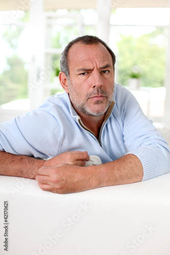 Portrait of senior man with interrogative expression on his face