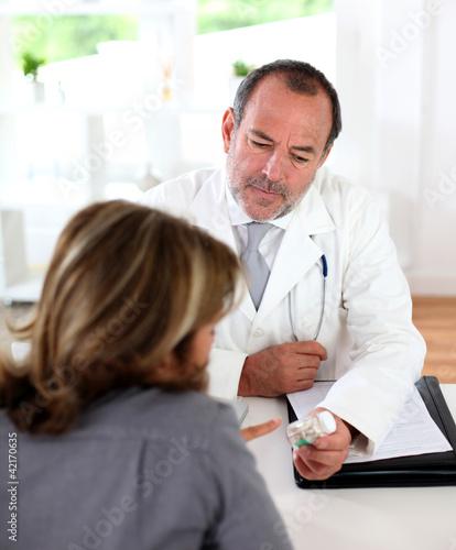Doctor prescribing medication to patient