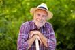 Portrait of senior gardener with straw hat