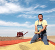 Agriculture, soybean harvesting farmer and combine