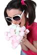 Woman scoffing marshmallows