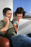 Elated couple learning happy news