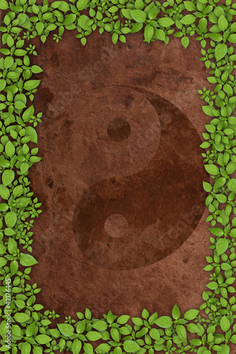 Yin Yang Symbol on old brown paper background