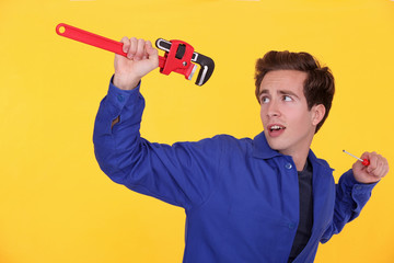 Man with a wrench and screwdriver