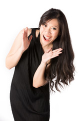 Happy Asian woman in black dress.