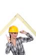 Carpenter standing under a wooden frame and shaking her finger