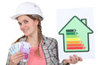 Woman holding energy score card and cash
