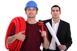 Tradesman posing with an engineer