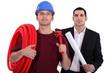 Tradesman posing with an engineer