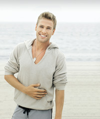 Young man with smile on beach
