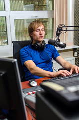 Dj working in front of a microphone on the radio