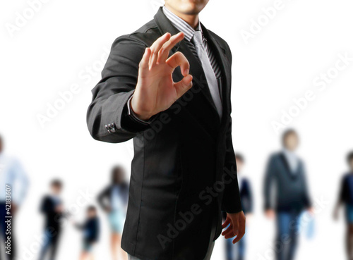 Business man's hand make OK isolated