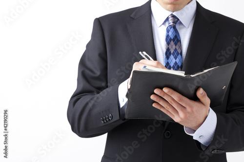メモを取るビジネスマン