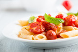 Penne pasta with cherry tomatoes and basil