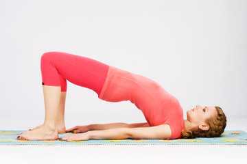 Sporty woman doing stretching exercise. Bridge pose.