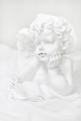Sculpture of an angel on white background