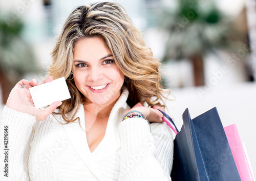 Shopping woman holding contact card